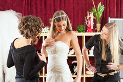 Bride at the clothes shop for wedding dresses Royalty Free Stock Photography