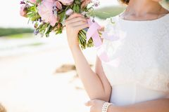Bride on the coast of the sea stock images