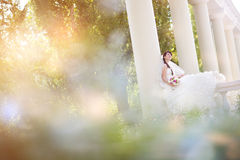 Bride in columns Stock Images
