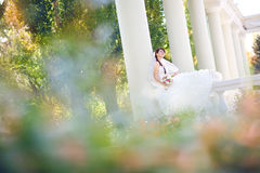 Bride in columns and leaves Royalty Free Stock Images