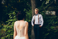 Bride comes to the groom. On the lawn in the forest stock images