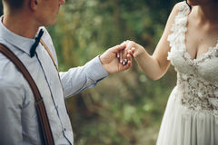 Bride comes to the groom. On the lawn in the forest, close stock images
