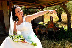 Bride communication. Bride communicate with guest´s with her´s finger pointed Stock Photo