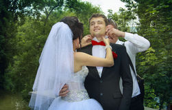 Bride corrects the tie Royalty Free Stock Photography