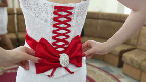 Bride corset tie on the back of a red ribbon stock video