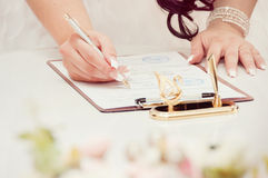 Bride couple signs documents Stock Photo