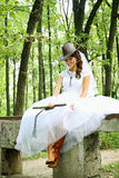Bride cowboy. Beautiful bride in a cowboy hat and whip stock photos