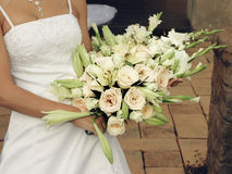 Bride with cream roses and lilies Stock Photo