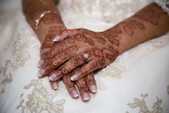 Henna Hands. Bride crossed hands showing henna Stock Photos