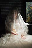 The bride with a crystal shoe. Royalty Free Stock Photos