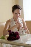 Bride with cup of coffee. Royalty Free Stock Photography