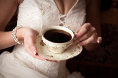 The bride with a cup of coffee Royalty Free Stock Photos