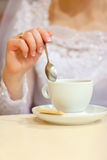 Bride and cup of coffee Stock Photos