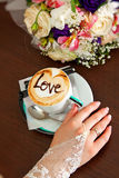 Bride and a cup of coffee with love Stock Photos