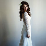 Bride with curly dark hair staying in full-length. A Stock Photo