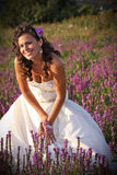 Bride with curly hair. Bride posing in a natural environmant stock photography