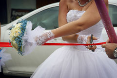 Bride cuts the ribbon Royalty Free Stock Photos