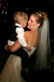 Bride dancing with son. Beautiful bride dancing with her toddler son Stock Image