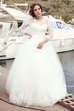 Bride with dark hair in luxurious lace wedding dress posing beside yacht royalty free stock photo