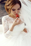 Bride with dark hair in luxurious lace wedding dress posing on yacht royalty free stock photo