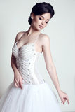 Bride with dark hair in luxurious wedding dress Royalty Free Stock Image