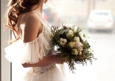 Bride with dark hair in a white wedding dress with stock photo