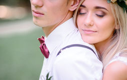 Free Bride Daydreams On Groom`s Shoulder While Hugging Him From Behind Stock Images - 95663104