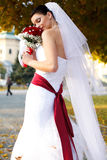 Bride daydreams smelling her bouquet Royalty Free Stock Photo