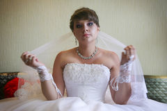 Bride demonstrating her lace decor. Red lips Stock Photos