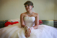 Bride demonstrating her lace decor. Red lips Royalty Free Stock Photo