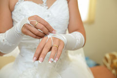 Bride details. Bride wedding dress. Hands details Royalty Free Stock Photography