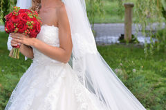 Bride details. Bride wedding dress details holding flower bouquet Stock Image