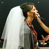 Bride is doing make up  for her wedding Stock Photo