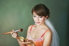 Bride doing make-up in the morning. Royalty Free Stock Photos