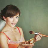 Bride doing make-up in the morning. Royalty Free Stock Images