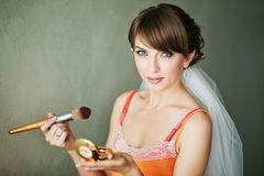 Bride doing make-up in the morning. Stock Image