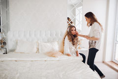 Bride doing makeup in the morning in a room. make-up artist doing professional make up of young woman. make-up artist Stock Photography