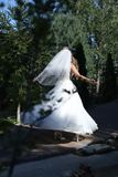 Bride doing pirouette in the park Royalty Free Stock Photos