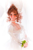 Bride doll. In a white dress royalty free stock image