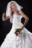 Bride doll with a bouquet of tulips Royalty Free Stock Images