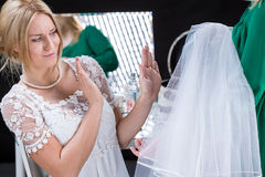 Bride with doubts before wedding Stock Photo