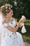 Bride and dove. Bride keeps in hand of the dove Stock Photography