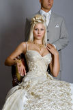 Bride in dress. Beautiful bride looks very nice with a man stock photo