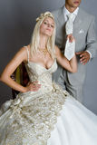 Bride in dress. Beautiful bride looks very nice with a man royalty free stock image