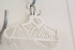 Bride dress is on the decorated hanger Stock Photos