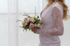 Bride in dress with flowers Royalty Free Stock Photography