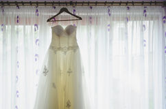Bride dress in front of window. At the weeeding day Royalty Free Stock Photo