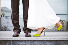 Bride in dress ,the green shoes Royalty Free Stock Images