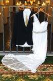 Bride Dress and Groom Suit Stock Images