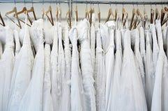 Bride dress hanging on shelf Stock Images